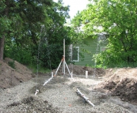 Gravity powered 'Flout' dosing of pressure septic field.  Crawford Bay. BC.